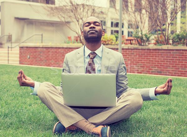 Fiatal üzletember laptop meditál lótusz póz Stock fotó © ichiosea