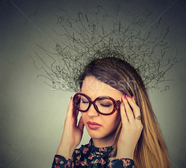 woman with worried stressed face expression and brain melting into lines question marks Stock photo © ichiosea