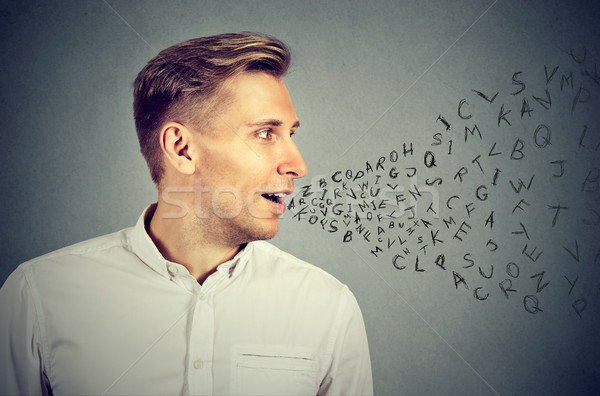 Man talking with alphabet letters coming out of his mouth Stock photo © ichiosea