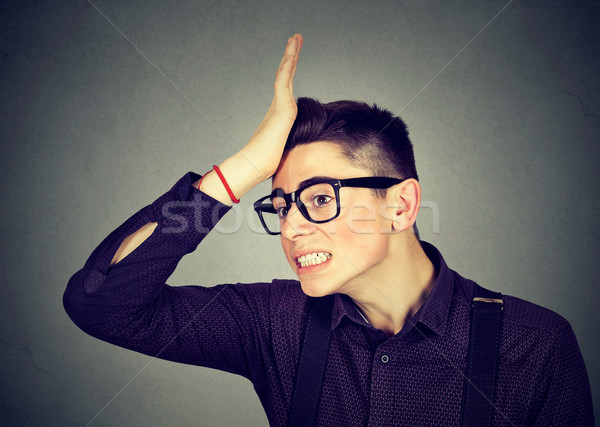 Wrong. Silly man slapping hand on head having duh moment  Stock photo © ichiosea
