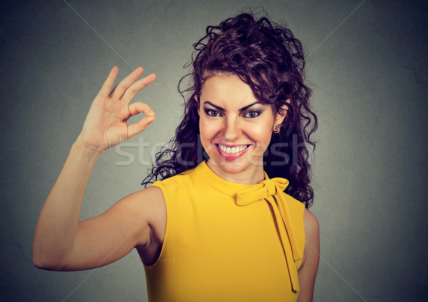 Laughing woman in yellow dress showing ok sign  Stock photo © ichiosea