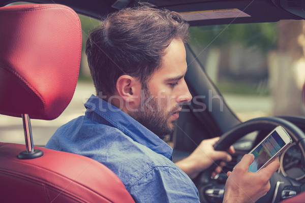 Man using cell phone texting while driving. Reckless driver Stock photo © ichiosea