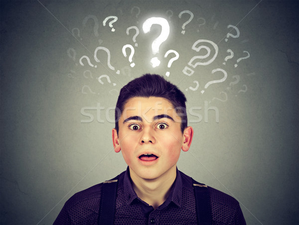 Shocked young man with many questions and no explanation or answer   Stock photo © ichiosea
