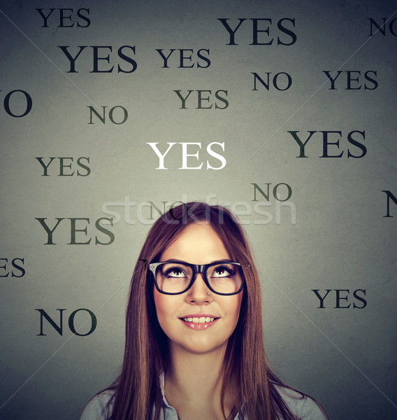 Young woman thinking yes or no Stock photo © ichiosea