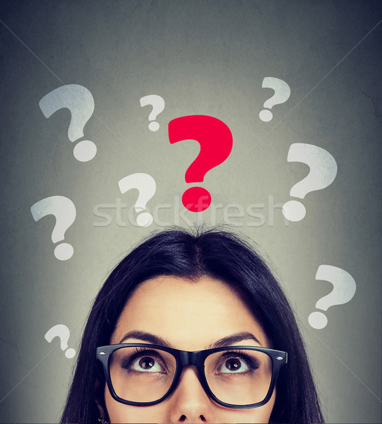 Serious woman looking up at key question  Stock photo © ichiosea
