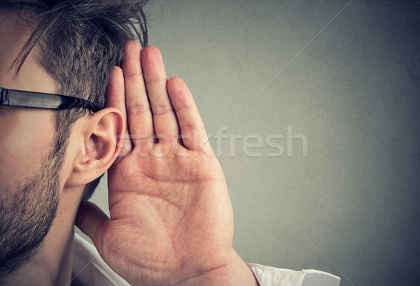 man holds his hand near ear and listens carefully Stock photo © ichiosea