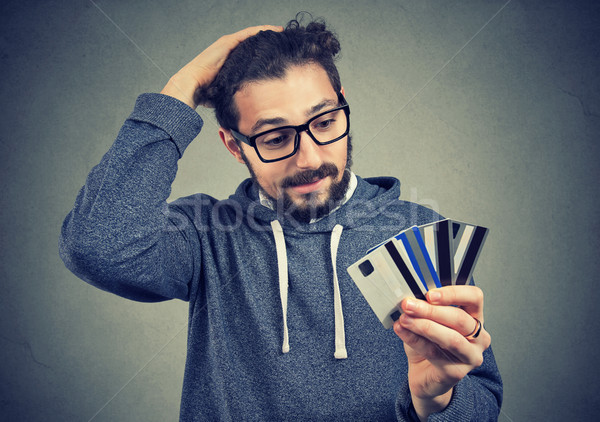 отчаянный человека заем молодым человеком очки Сток-фото © ichiosea