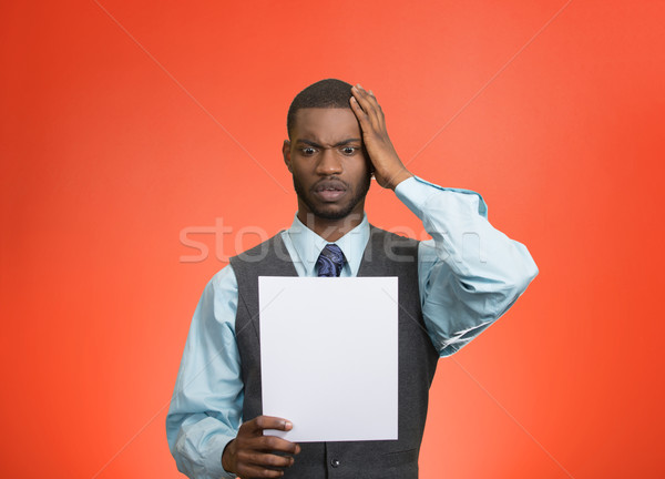 Man holding paper, statement, shocked with bad news Stock photo © ichiosea