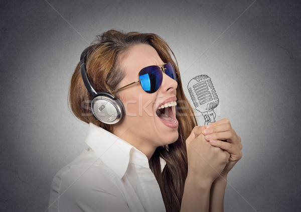 woman with sunglasses singing with microphone Stock photo © ichiosea