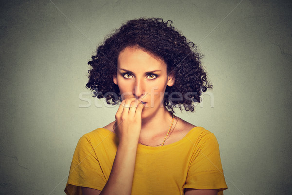 nervous looking woman biting her fingernails craving something anxious  Stock photo © ichiosea