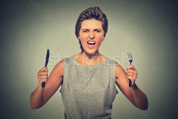 Portrait faim jeune femme hurlant visage Photo stock © ichiosea