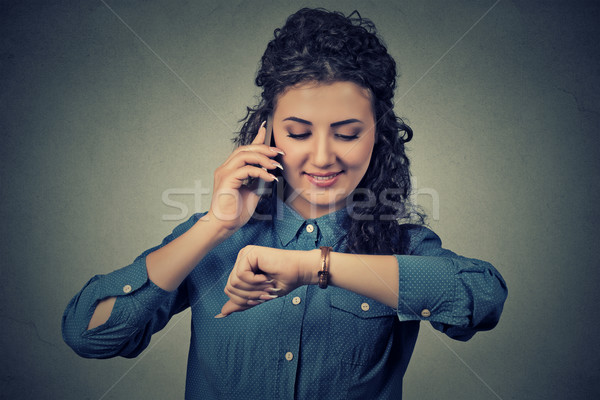 Business and time management. Happy business woman looking at wrist watch, running late for meeting Stock photo © ichiosea