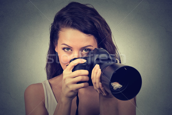 young woman taking pictures with professional dslr camera Stock photo © ichiosea