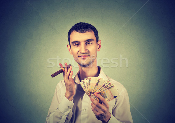 Boldog fiatal férfi Euro bankjegyek pénz Stock fotó © ichiosea