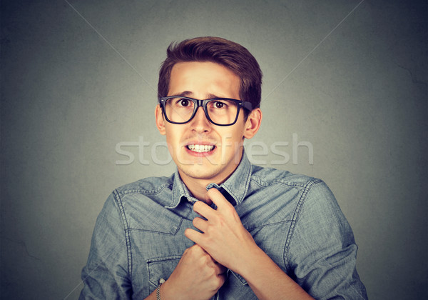 Nervous stressed man feels awkward looking anxiously craving something  Stock photo © ichiosea