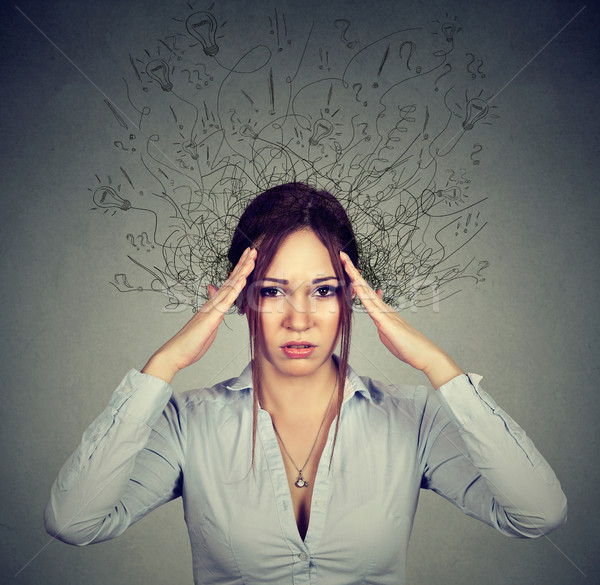 woman with worried stressed face expression brain melting into lines  Stock photo © ichiosea