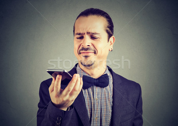 Man dissatisfied with new smartphone Stock photo © ichiosea
