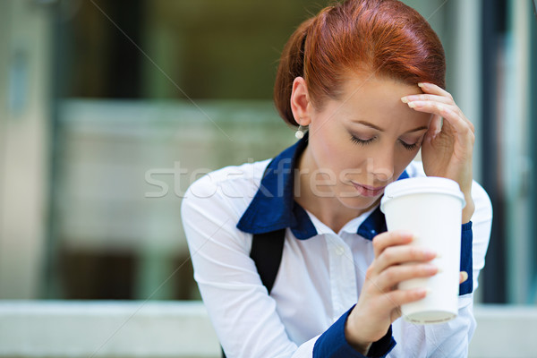 Portrait of a stressed businesswoman having headache Stock photo © ichiosea