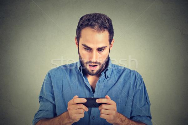 Endişeli adam bakıyor telefon kötü haber fotoğrafları Stok fotoğraf © ichiosea