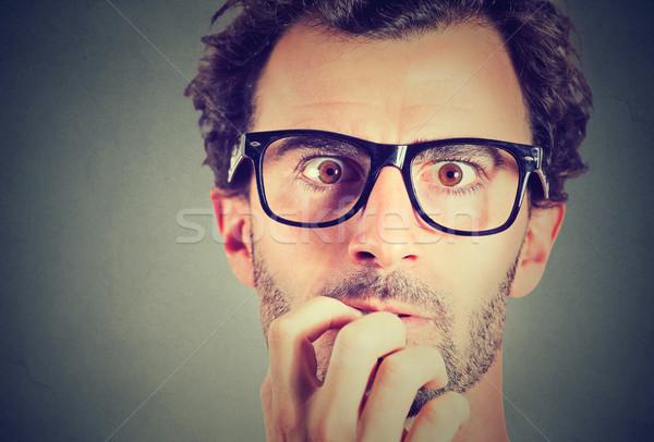 Anxious stressed young man looking at camera Stock photo © ichiosea