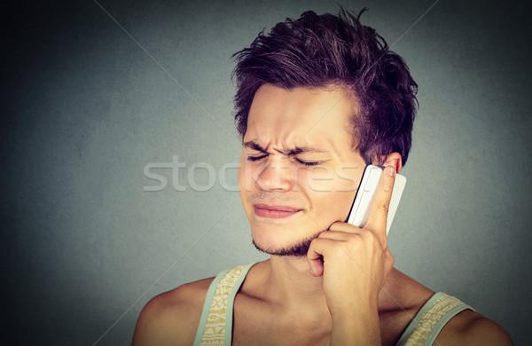 Man talking on mobile phone having headache Stock photo © ichiosea