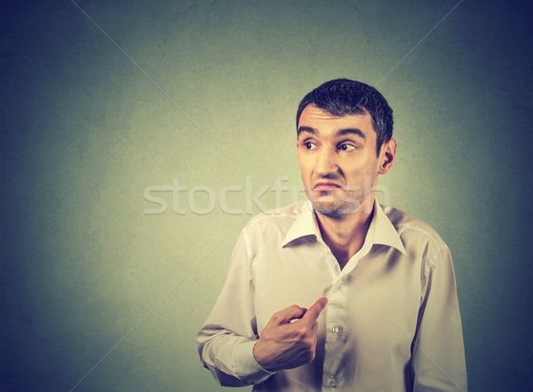 young guy pointing at himself you mean me  Stock photo © ichiosea