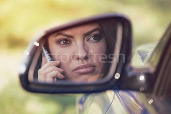 Donna guida auto parlando telefono infastidito Foto d'archivio © ichiosea