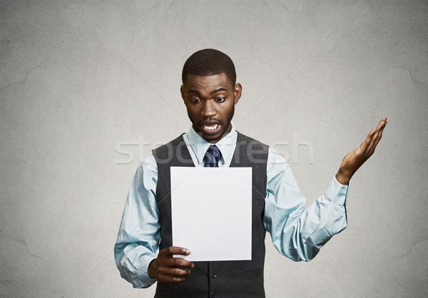 Férfi tart papír megrémült rossz hírek közelkép Stock fotó © ichiosea