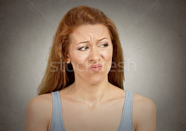 Stock photo: Upset disgusted woman