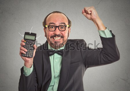 angry businessman tearing a document to pieces Stock photo © ichiosea