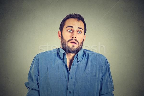 Yakışıklı adam omuzlar cehalet portre Stok fotoğraf © ichiosea