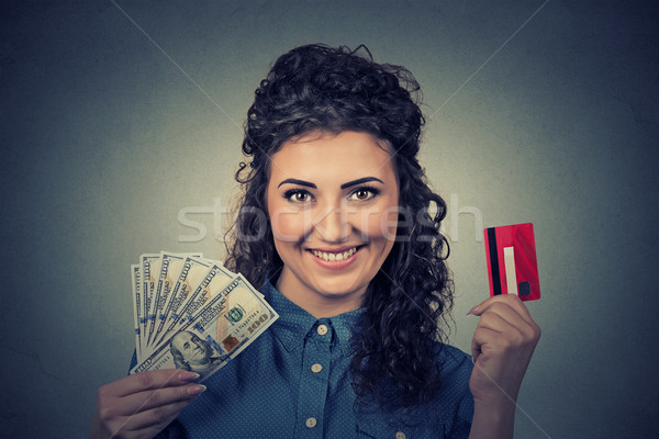 woman holding showing credit card and cash dollar banknotes bills  Stock photo © ichiosea