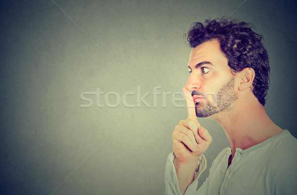 silence quiet gesture. Side profile man making hush sign  Stock photo © ichiosea