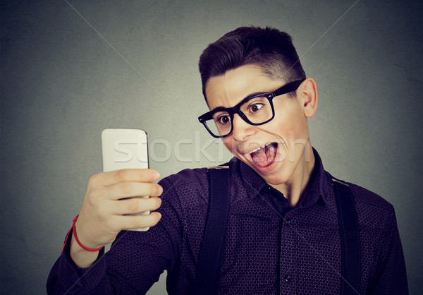 funny looking man taking pictures of him self with smart phone Stock photo © ichiosea