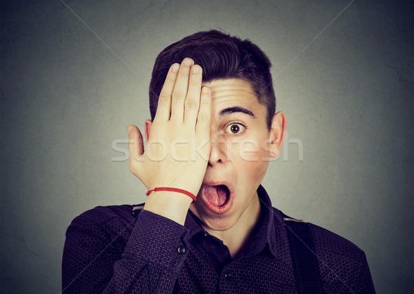 Сток-фото: удивленный · человека · глаза · стороны · изолированный · серый