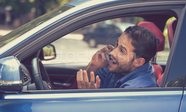 man talking on mobile phone while dangerously driving car Stock photo © ichiosea