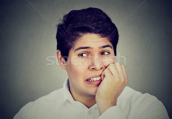anxious man biting his fingernails freaking out Stock photo © ichiosea