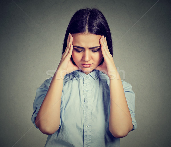sad beautiful woman with worried stressed face expression looking down   Stock photo © ichiosea