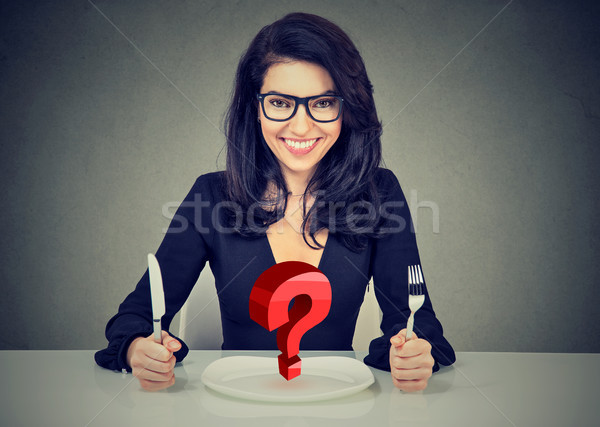 Happy woman with fork and knife sitting at table with empty plat Stock photo © ichiosea