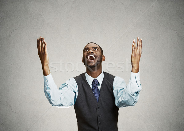 Excited happy man celebrates success, good outcome Stock photo © ichiosea