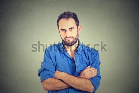 Stock photo: Young man with stomach pain indigestion