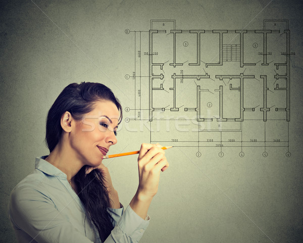 Happy young woman drawing new house floor plan with pencil  Stock photo © ichiosea