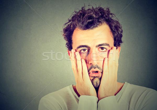 Portré kétségbeesett boldogtalan férfi izolált szürke Stock fotó © ichiosea