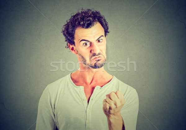 Angry funny looking man  Stock photo © ichiosea