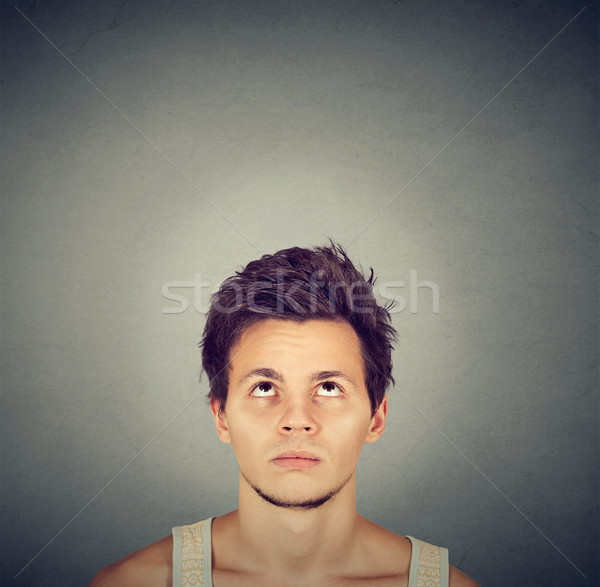 Confused man thinking looking up copy space above head  Stock photo © ichiosea