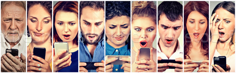 Stock photo: Surprised shocked group of people men women texting on smart phone