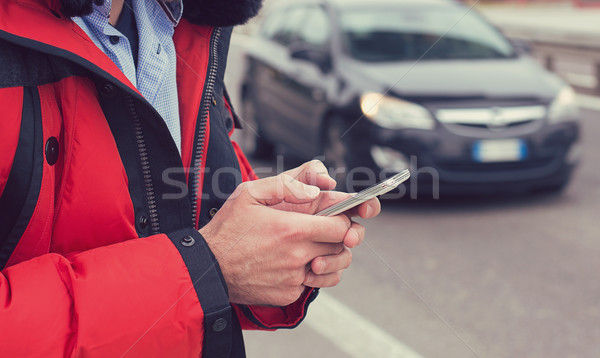 Közelkép férfi kezek hív taxi okostelefon Stock fotó © ichiosea