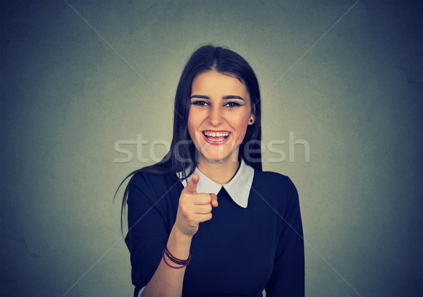 Laughing woman pointing finger at camera  Stock photo © ichiosea