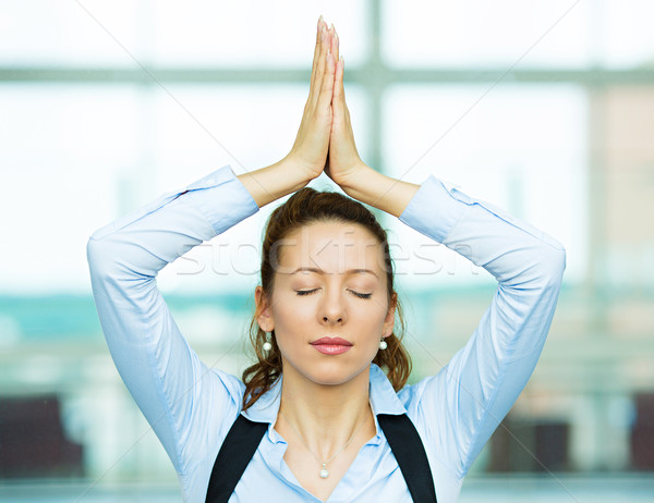 Meditating business woman Stock photo © ichiosea