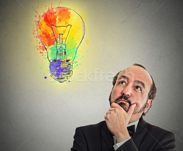 Człowiek zamyślony żarówka głowie w średnim wieku człowiek biznesu Zdjęcia stock © ichiosea